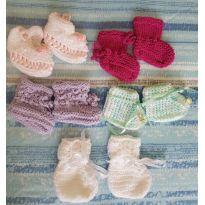 5 pares de sapatinhos em lã