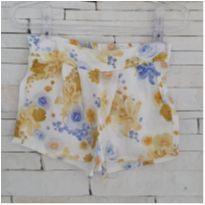 Shorts floral amarelo Tam. 1 menina - 1 ano - etiqueta foi cortada