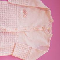 Casaco em linha rosa bebe